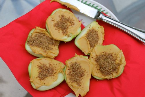 Green apples with soy butter and flaxseed that are quick easy snacks