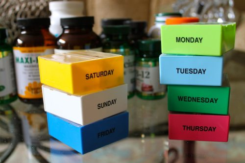 Vitamins-with-pill-cases-Monday-through-Sunday