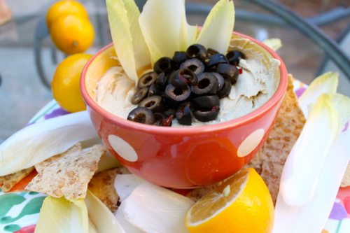 Hummus-and-jalapeno-stuff-black-olives-with-brown-rice-chips