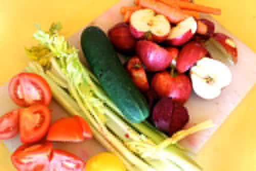 Juicer-Detox-Cleanse-with-fresh-veggies-and-fruits-with-celery-lemon-tomatoes-cucumbers-and-beets